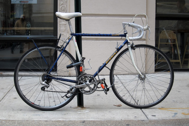 A vintage Nishiki road bike secured by a Kryptonite Series 2 Standard U-Lock and a Kryptonite Kryptoflex Cable