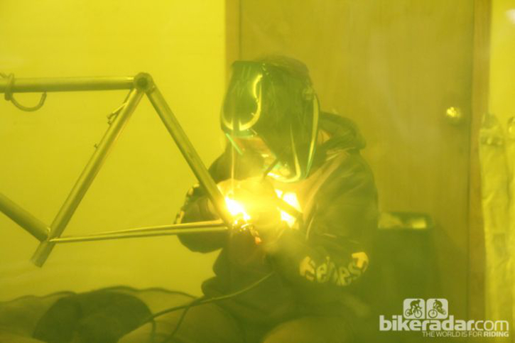 Dean Bikes founder John Siegrist welding a titanium bicycle frame in 2013. Image courtesy of Bicycle Radar.