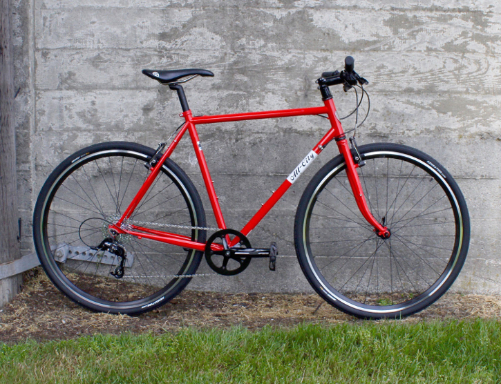All-City Pony Express Bike against a Gray Wall